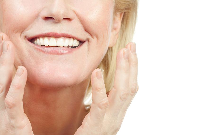 closeup portrait of attractive caucasian smiling old mature wom