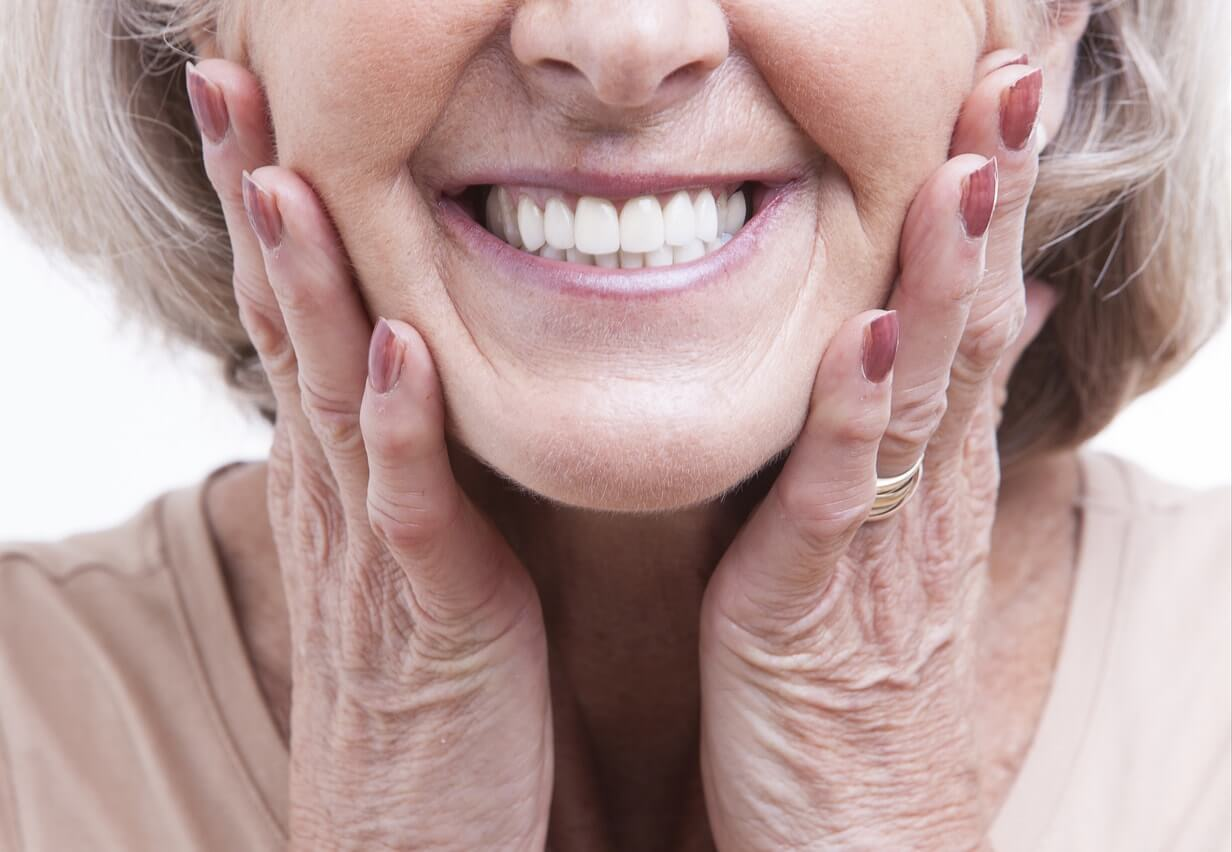 Senior woman with dentures showing off her smile
